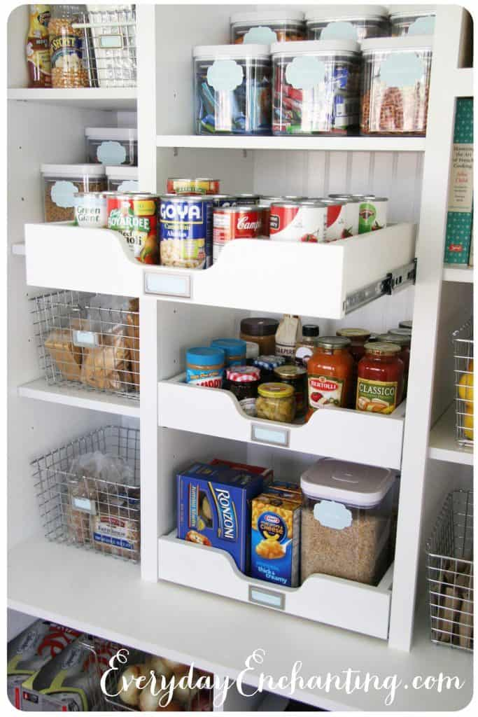 Pull out drawers of canned goods in pantry