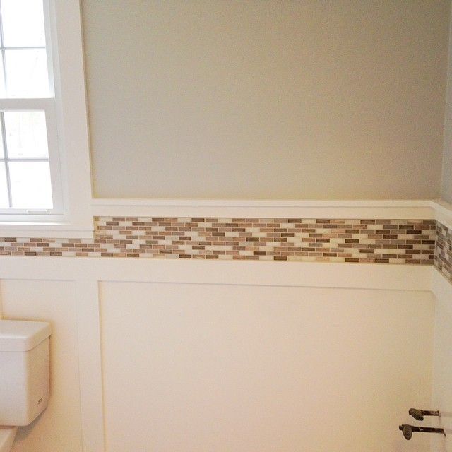 Grout=complete! (it's looking kind of beige- I'm hoping the gray comes back when I clean the haze off) and the toilet is back in place! It's coming together! #diy #powderroomreno #remodel
