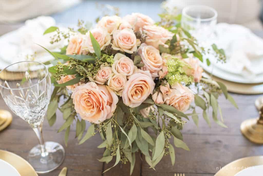 Blush Valentine's Day centerpiece with garden roses