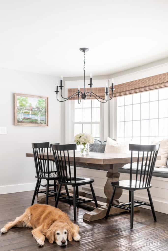 Family-friendly breakfast nook refresh with dark hardwoods and a trestle table