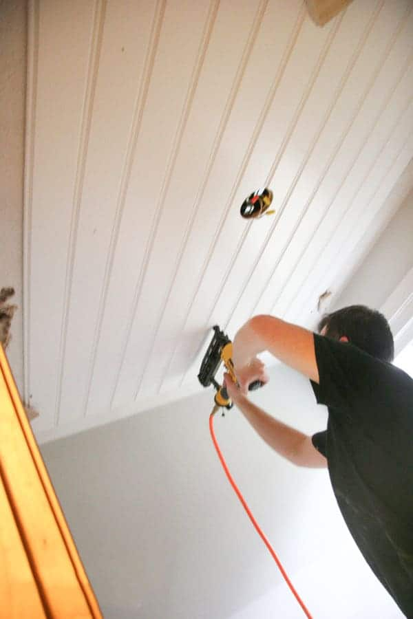 DIY Beadboard Ceiling Tutorial | Learn how to cover a dated, textured, and stained ceiling with a cottage style DIY beadboard ceiling for a custom look.