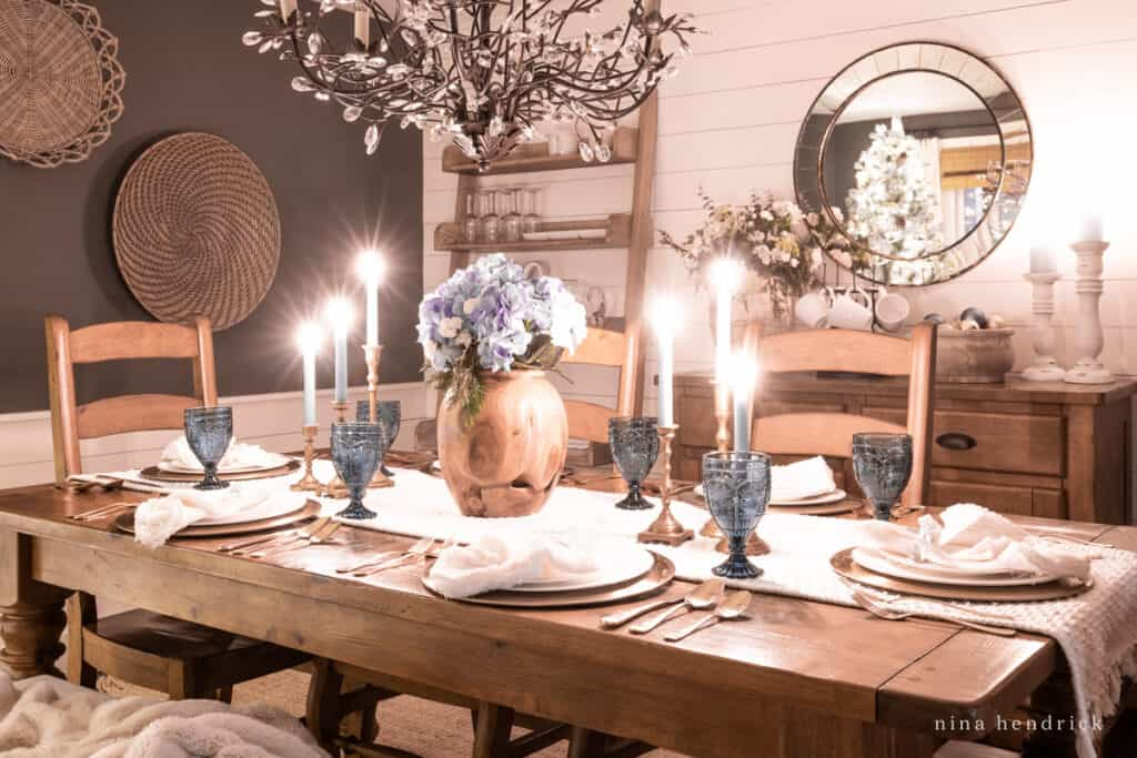 Dining room at night with tablescape and Christmas tree