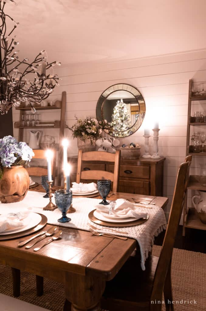 Tablescape home tour at night with buffet and Christmas tree lights in mirror