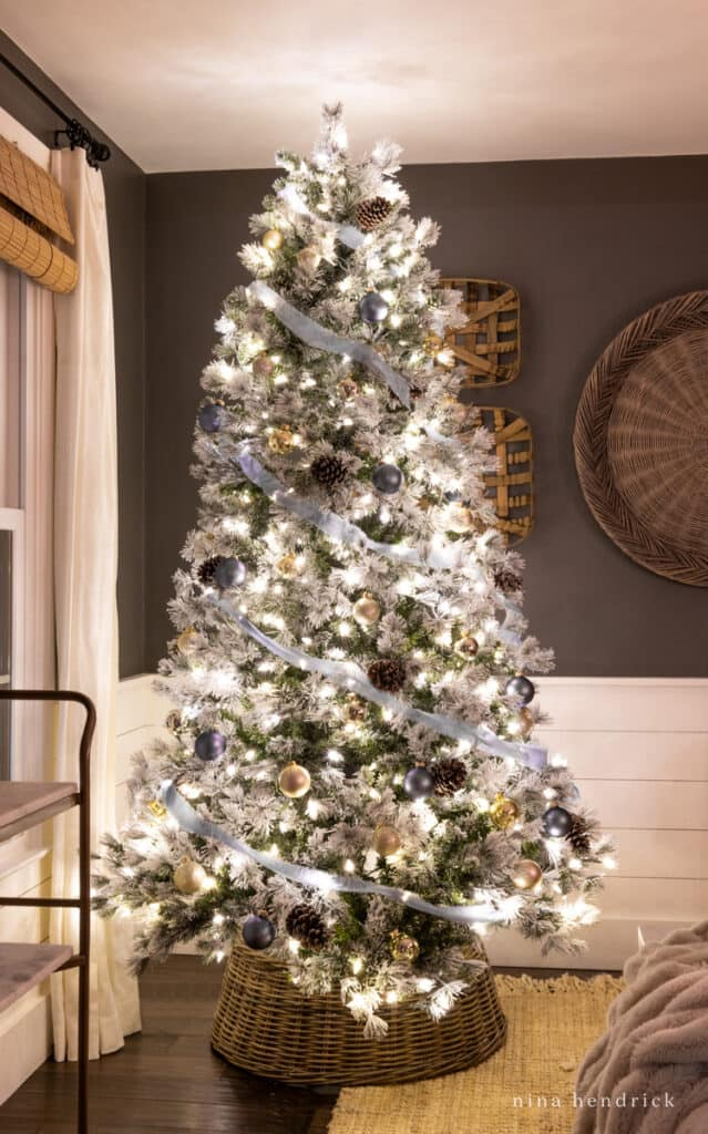 Christmas tree at night with blue ribbon and ornaments