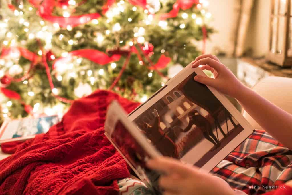 Reading the Polar Express in a Christmas Night Home Tour