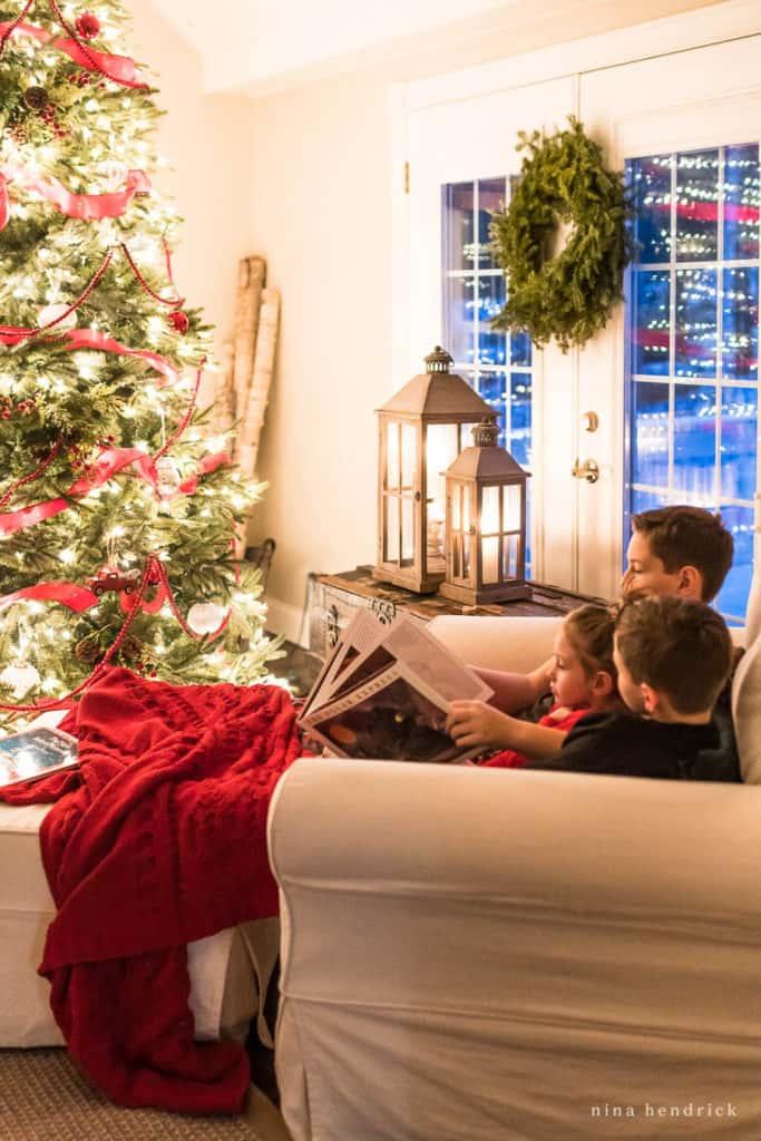 Children Reading in front of the Christmas tree © Nina Hendrick
