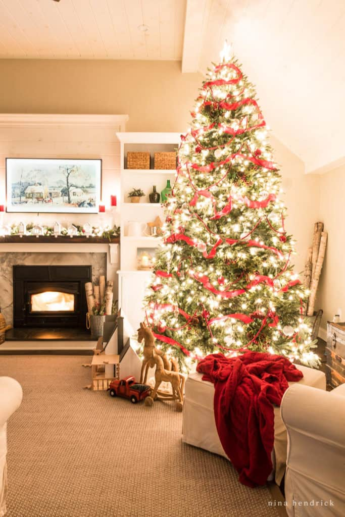 Christmas Night Home Tour with a family room all dressed up for the holiday with magical twinkling holiday lights.