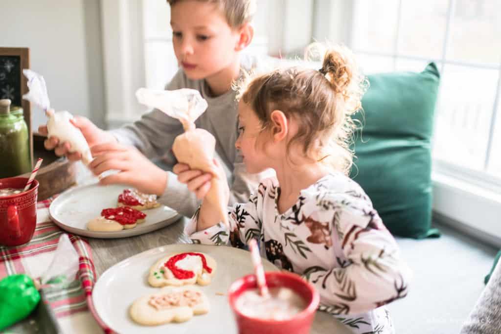 Making Christmas memories by decorating cookies