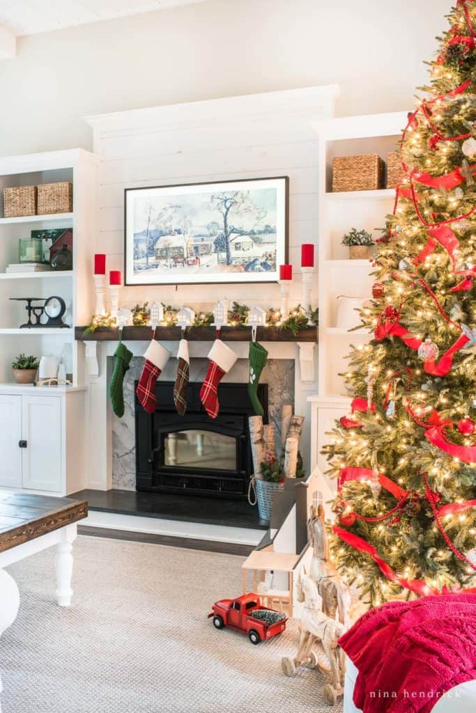 This Classic Christmas Family Room is decorated in traditional red and green with nostalgic and rustic touches to celebrate the season.