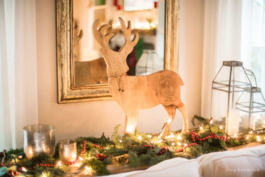 Wooden deer holiday vignette