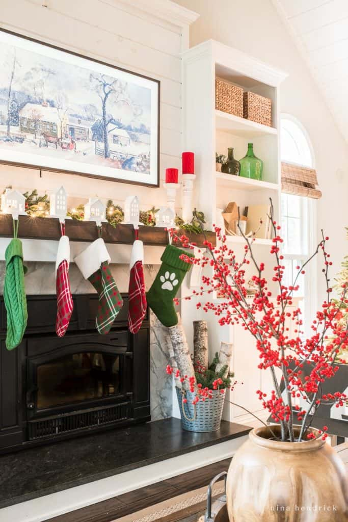 Mantel hung with stockings in a Classic Red and Green Family Room
