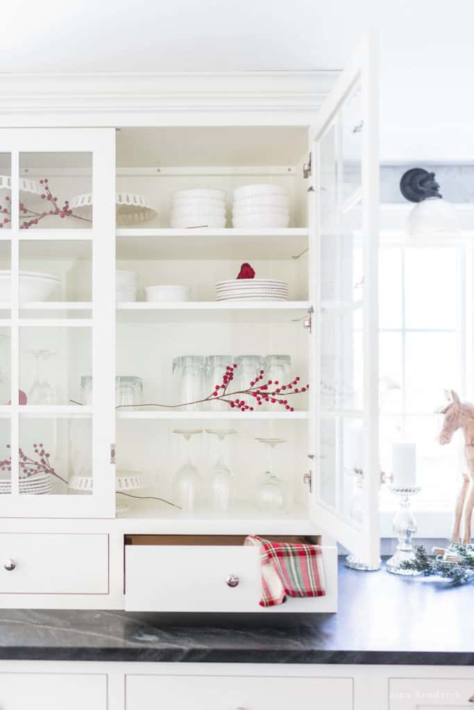Classic Christmas Kitchen hutch with red and white decor.
