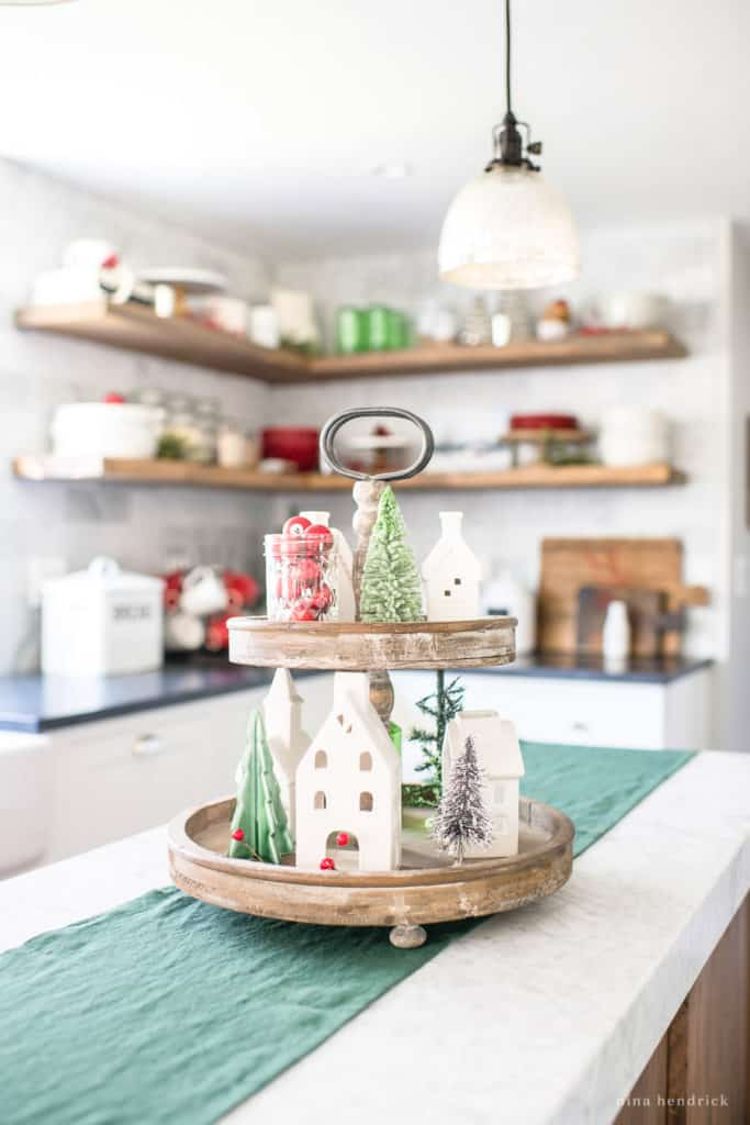 Tiered Tray featuring a white porcelain village in a Classic Christmas Kitchen
