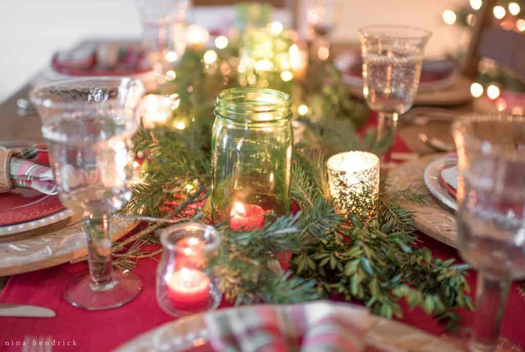 Christmas tabletop with candlelight and green mason jars