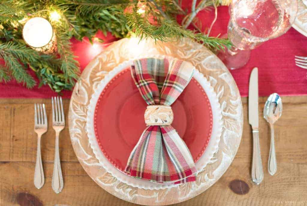 Christmas place setting with red and green plaid napkins