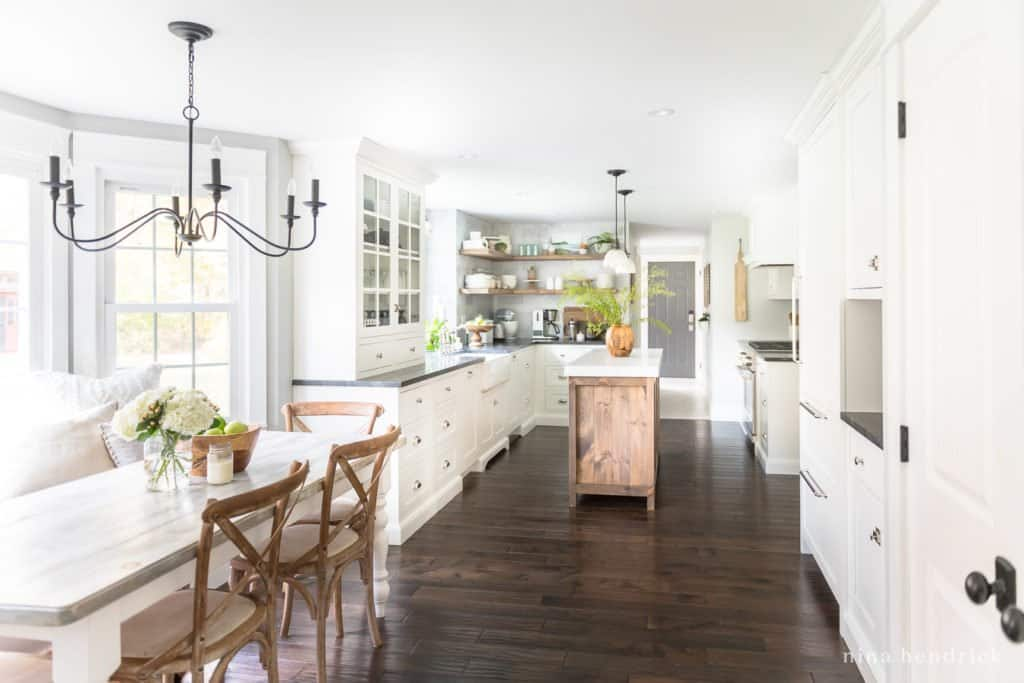 Classic kitchen with white cabinets and dark hardwood floors