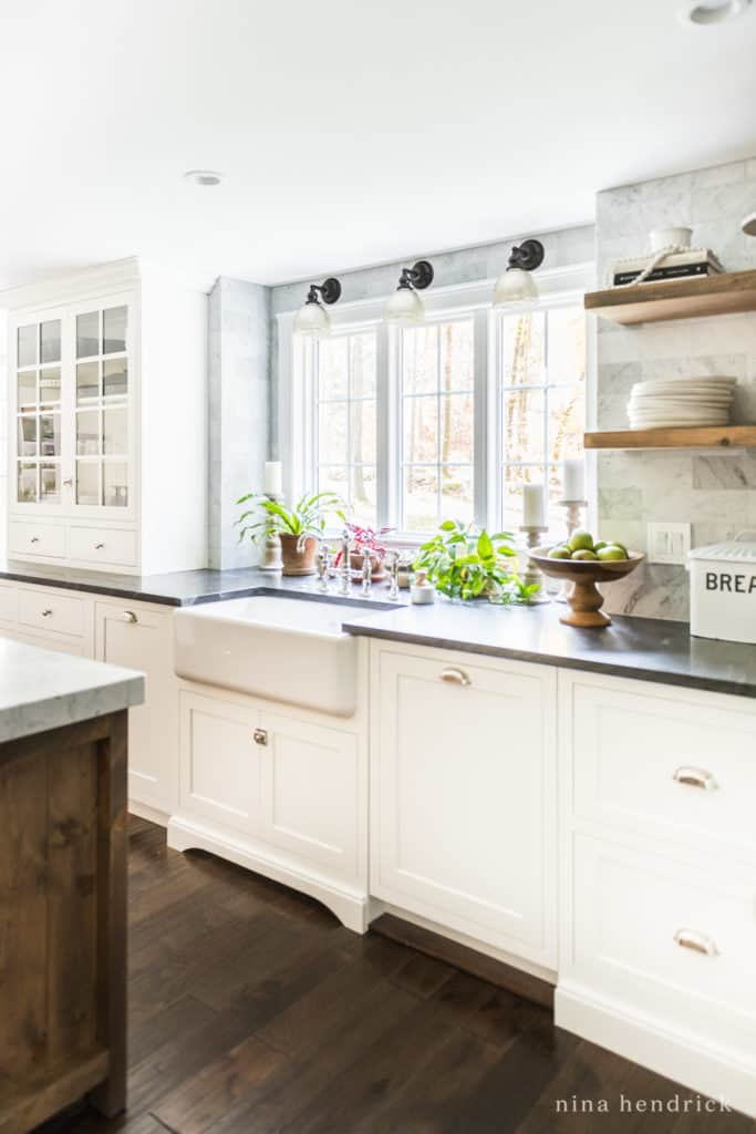Hidden dishwasher and trash cans in a classic kitchen renovation