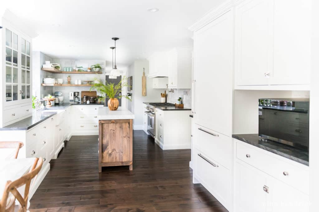 Classic white kitchen with built-in refrigerator