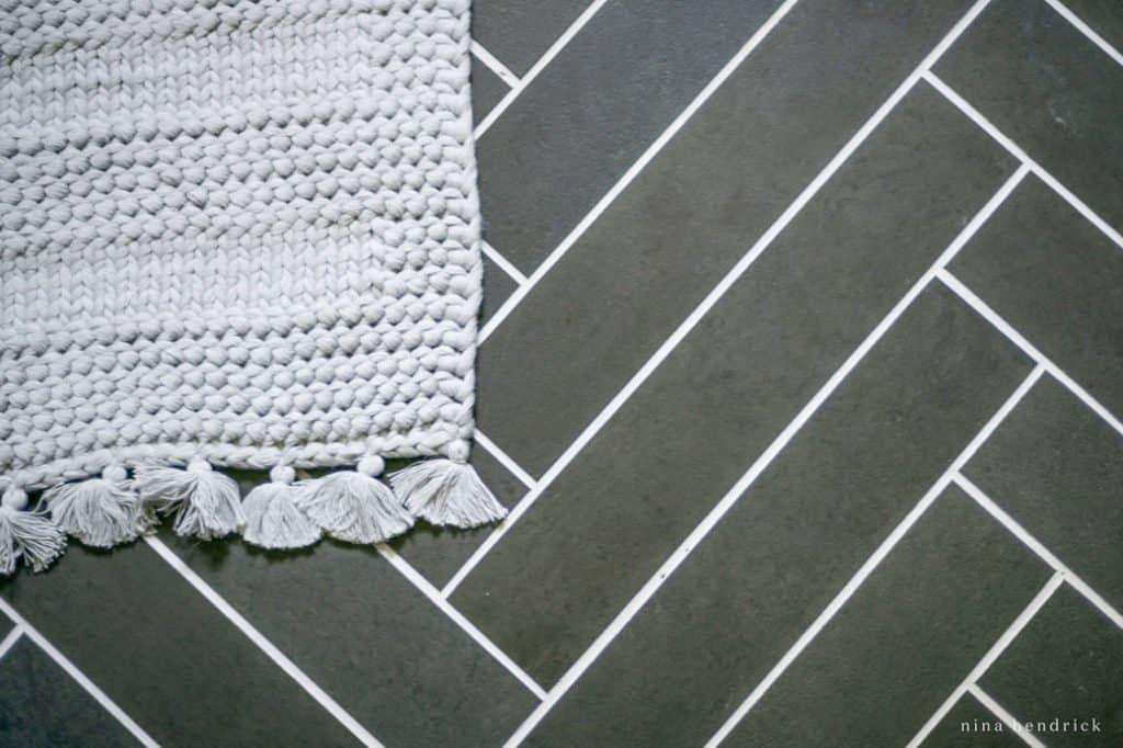 herringbone tile floor with slate-look porcelain