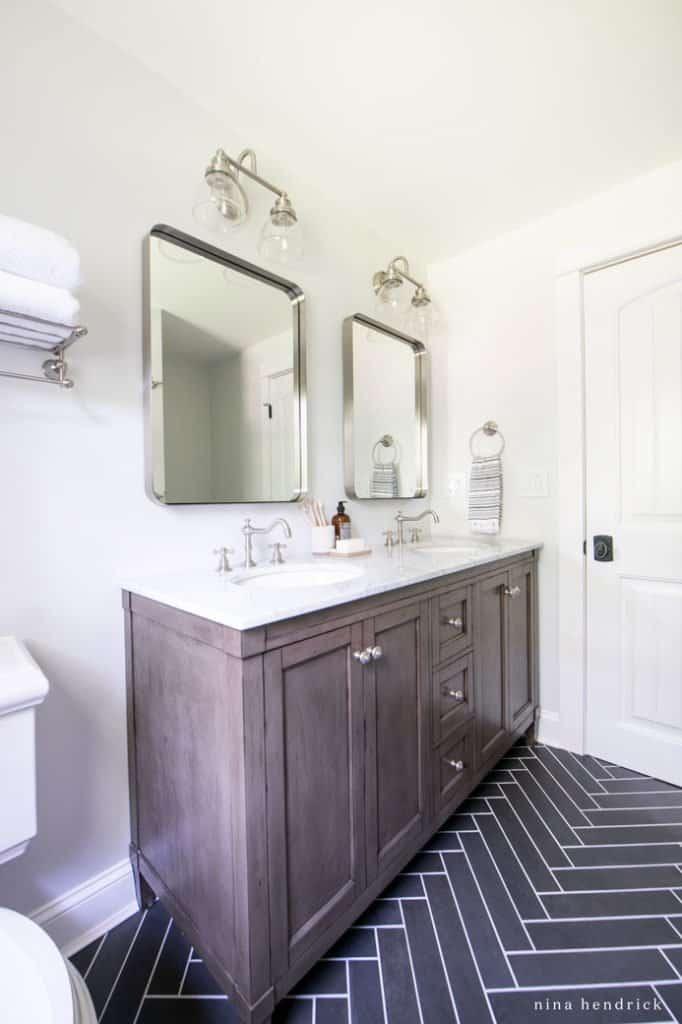 herringbone floor and vanity in a small bathroom makeover