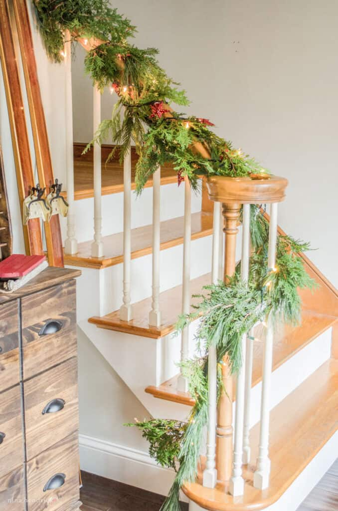 Stair banner with fresh green garland for a cozy Christmas decorating idea