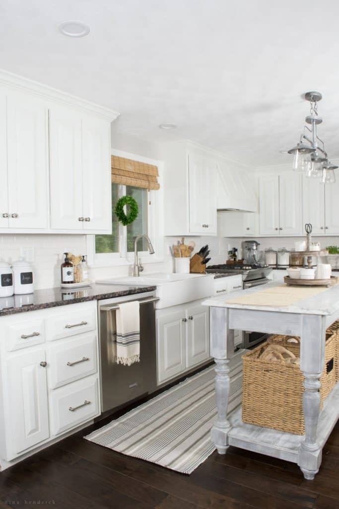 Over the past three years, we've been slowly and surely adding character to our blank-slate white painted farmhouse kitchen. Read on to see my tips and tricks for warming up the space including a striped runner from Annie Selke's Dash & Albert line!