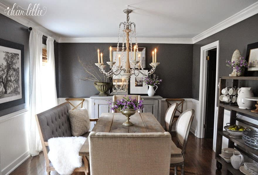 See the inspiration behind a Collected and Contrasting Dining Room Design. This room features a bold wall color, antique finishes, and a ton of texture.