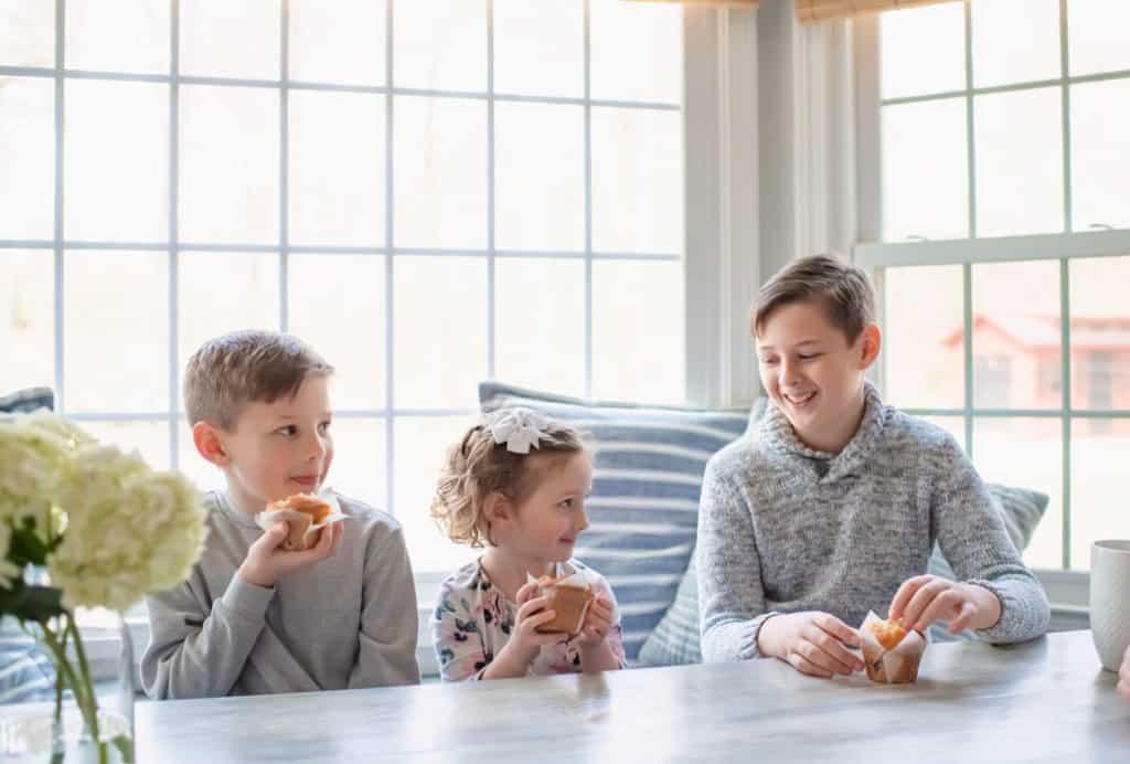Kids eating breakfast in breakfast nook