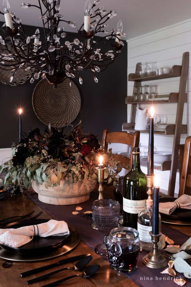 Elegant Halloween Tablescape with skull wine goblets and dark accessories