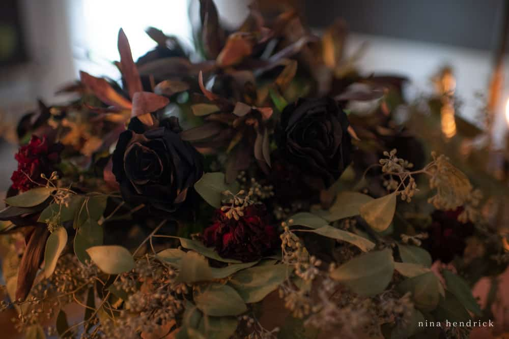 Spooky Halloween floral arrangement with black roses and dried leucadendron