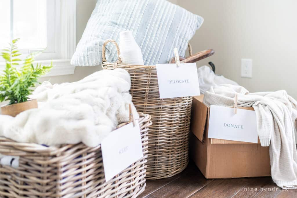 home organizing and decluttering with keep and donate boxes