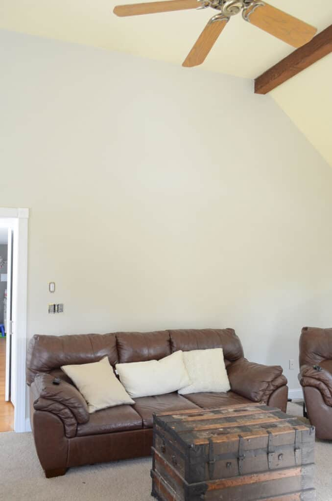 Cathedral wall before in the family room painted edgecomb gray.