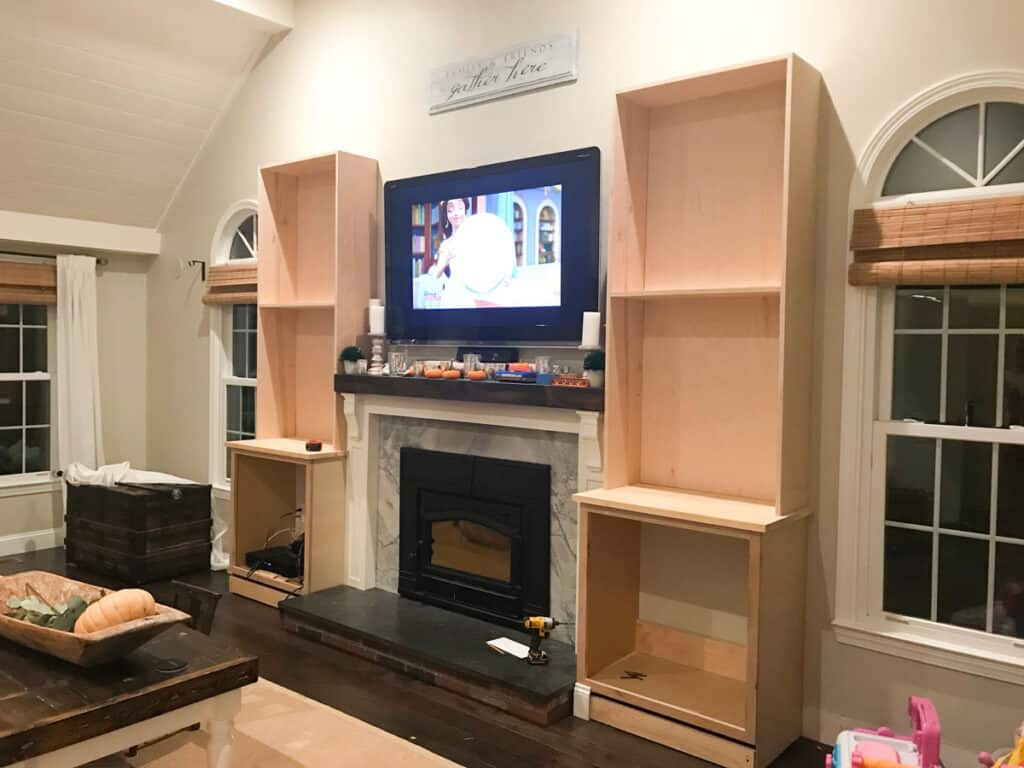 DIY Fireplace built-in cabinets from stock cabinets and custom bookshelves.