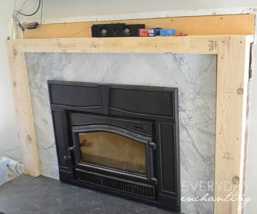 Learn how to cover your brick fireplace to transform it from dated to modern farmhouse style with stone
