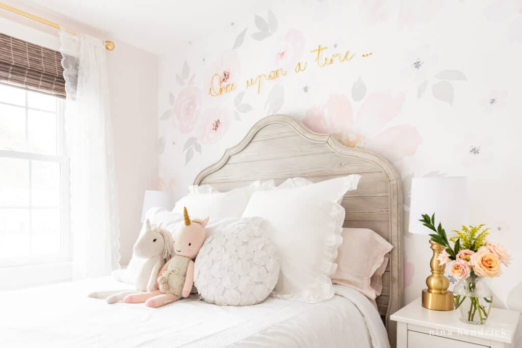 Fairy Tale Blush Floral Girl's Bedroom Makeover with stuffed animals and gold letters