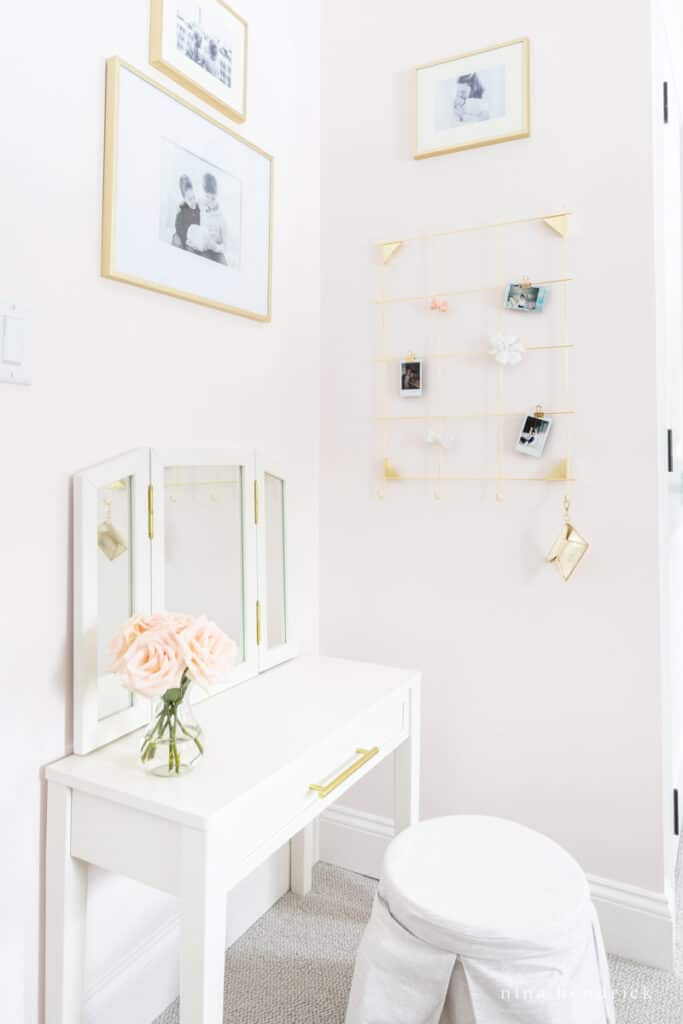Fairy Tale Blush Floral Girl's Bedroom Makeover with vanity and gallery wall