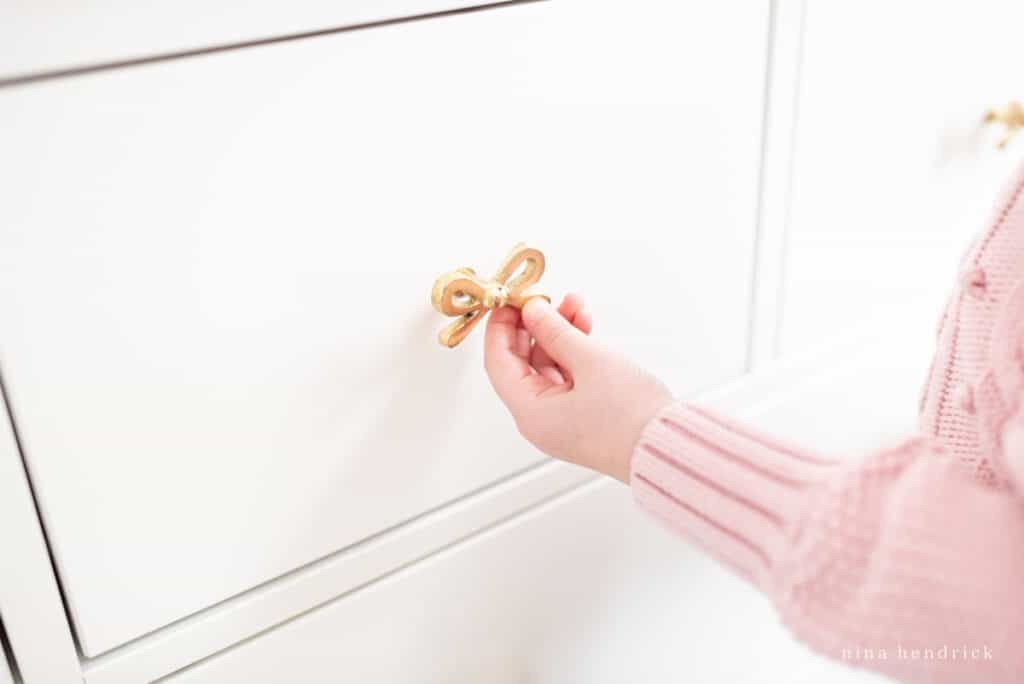 gold bow hardware on a dresser