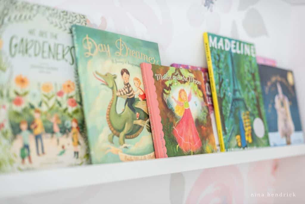 Fairy Tale Blush Floral Girl's Bedroom Makeover library on book ledge