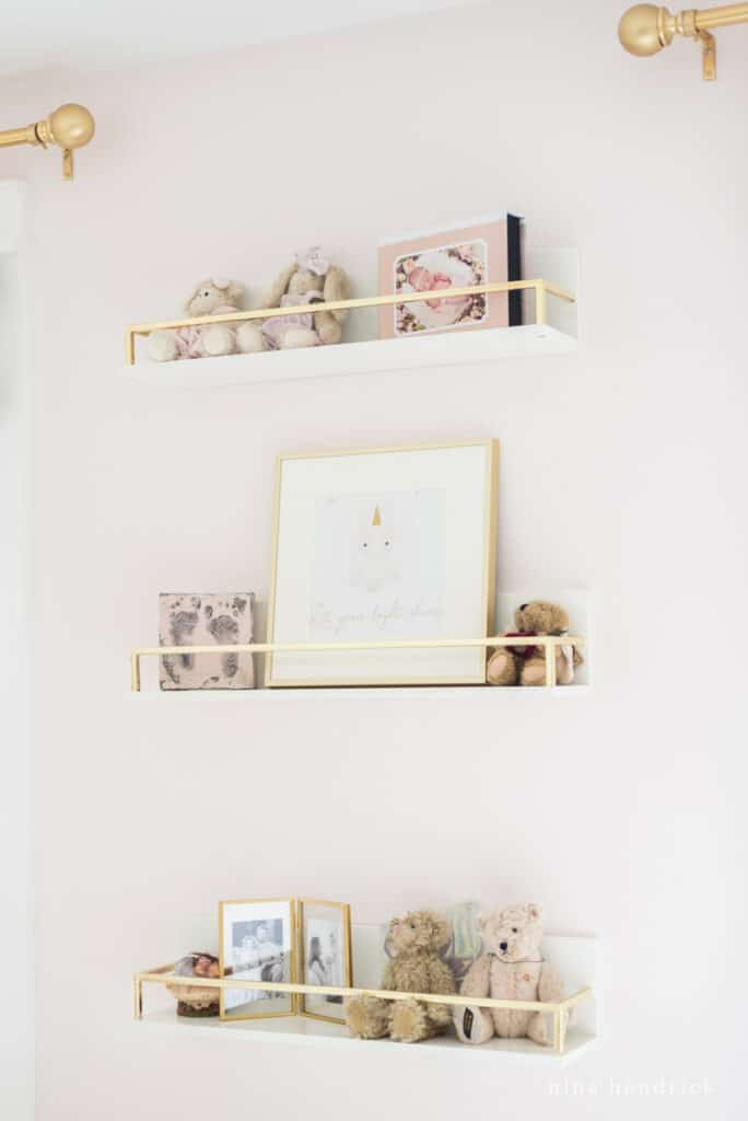 Gold shelves with bears and other sentimental items