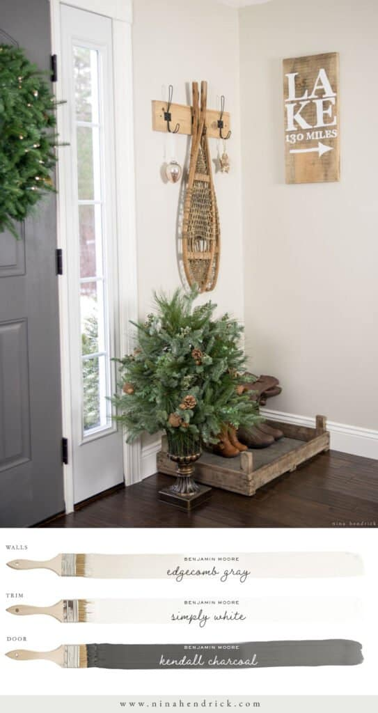 A neutral paint color scheme with Benjamin Moore Edgecomb Gray Foyer, Simply White trim, and a Kendall Charcoal door.