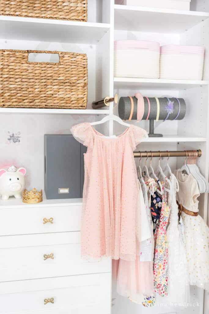Girl's organized closet with steaming hanger