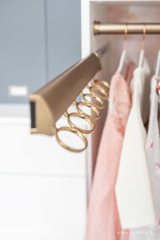 girl's organized closet scarf hangers
