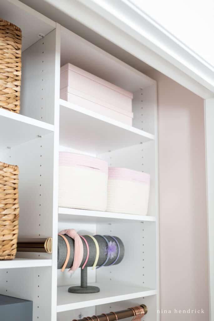 girl's organized closet rope baskets