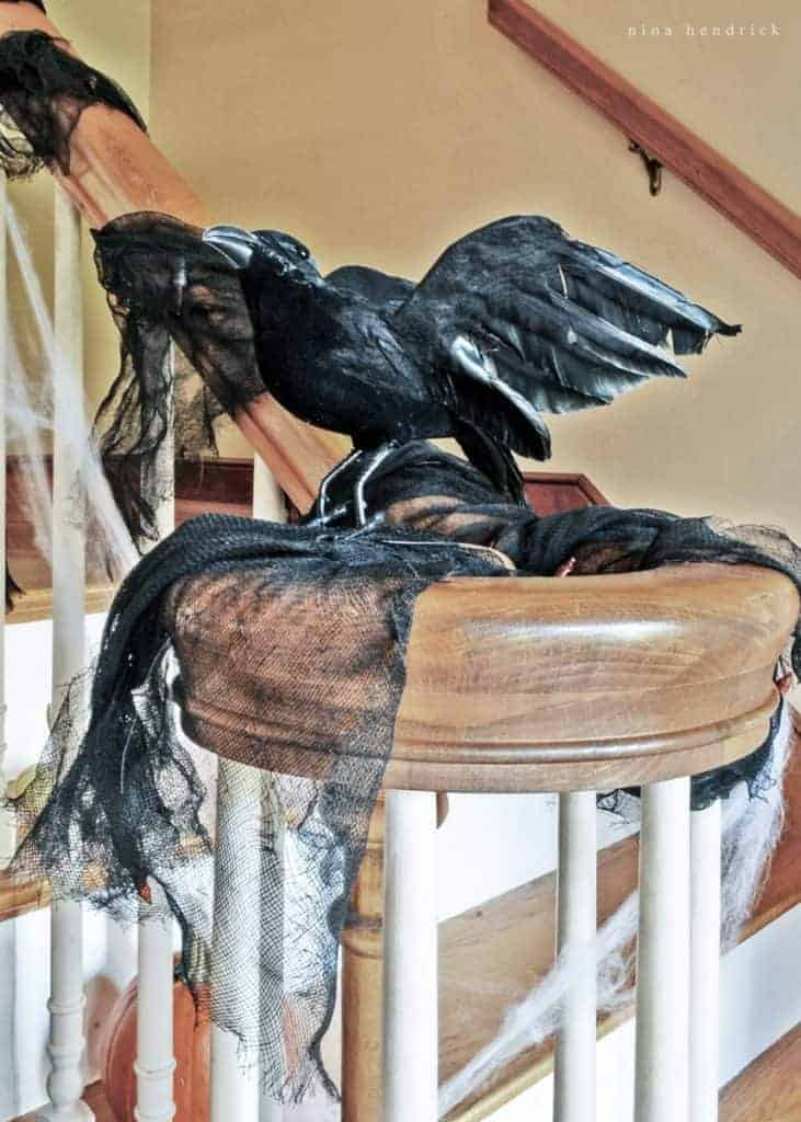 Get creepy crawly decorating inspiration from this vintage-inspired spooky Halloween foyer decor.