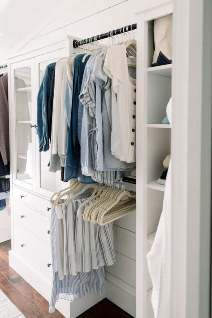 Home Renovation Goals | Organized Closet with blue capsule wardrobe and white cabinets