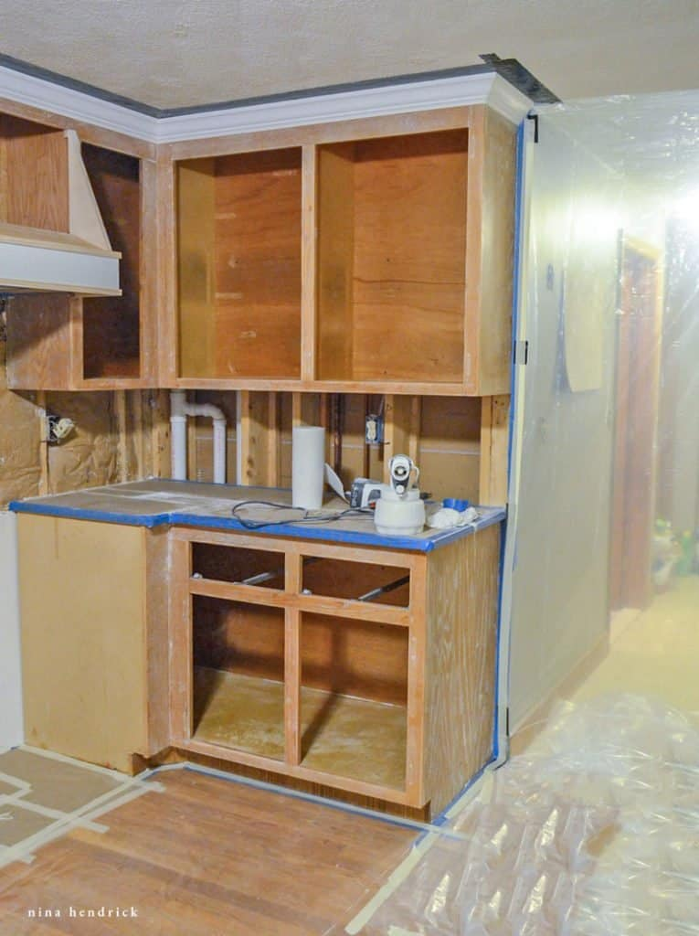 How to Paint Oak Cabinets Tutorial: Tape and Seal Off Your Kitchen to Protect from Overspray