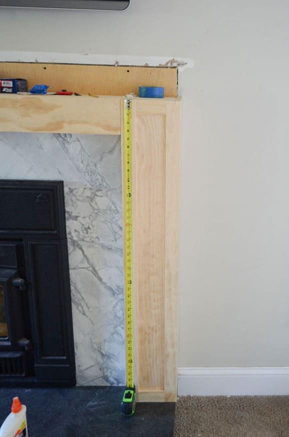 Adding pine trim box detail to a DIY wood fireplace surround