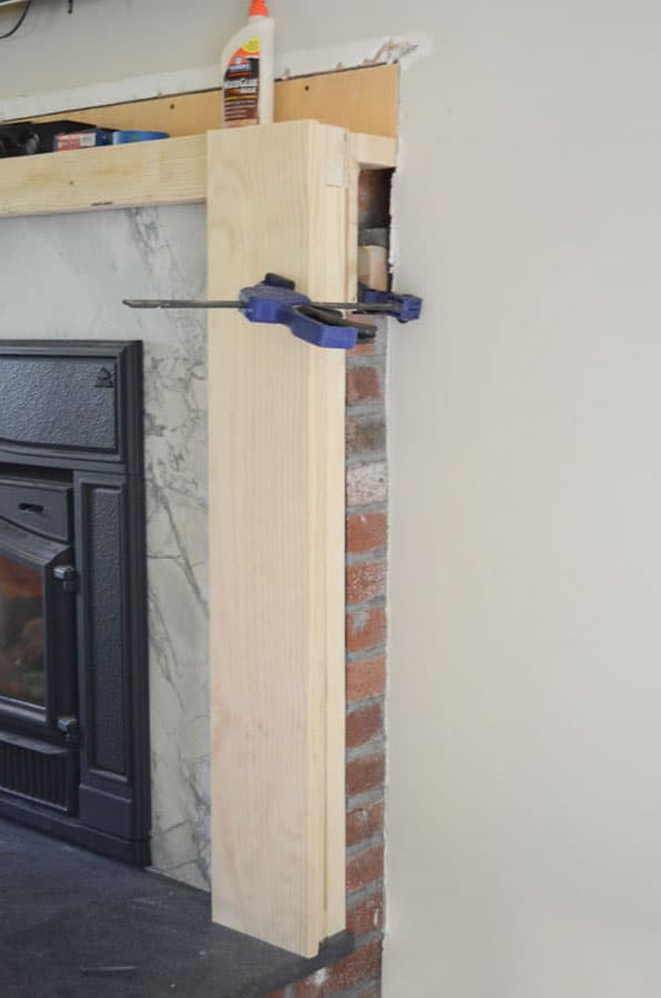 Wood framing to cover brick fireplace