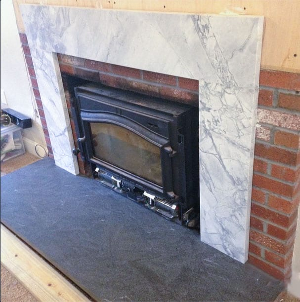 How to cover a brick fireplace with stone and wood