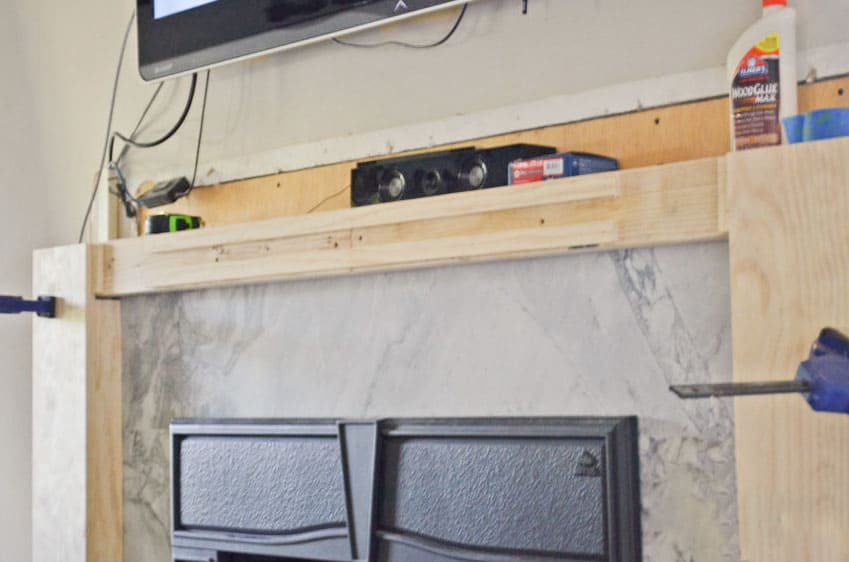 Adding spacers to a wood fireplace surround to ensure that the top board is flush with the eventual detail boards.